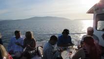 san-juan-cruises-chuckanut-bay-cracked-crab-cruise-guests-enjoying-sunshine